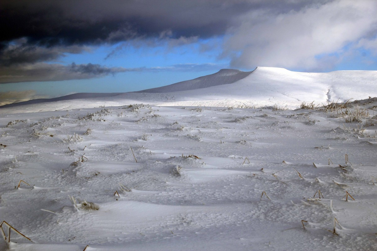 A snow covered Pen-y-Fan fromCraig Cerrig Gleisiad a Fan Frynych is a National Nature Reserve. Mountain Navigation for Photographers course