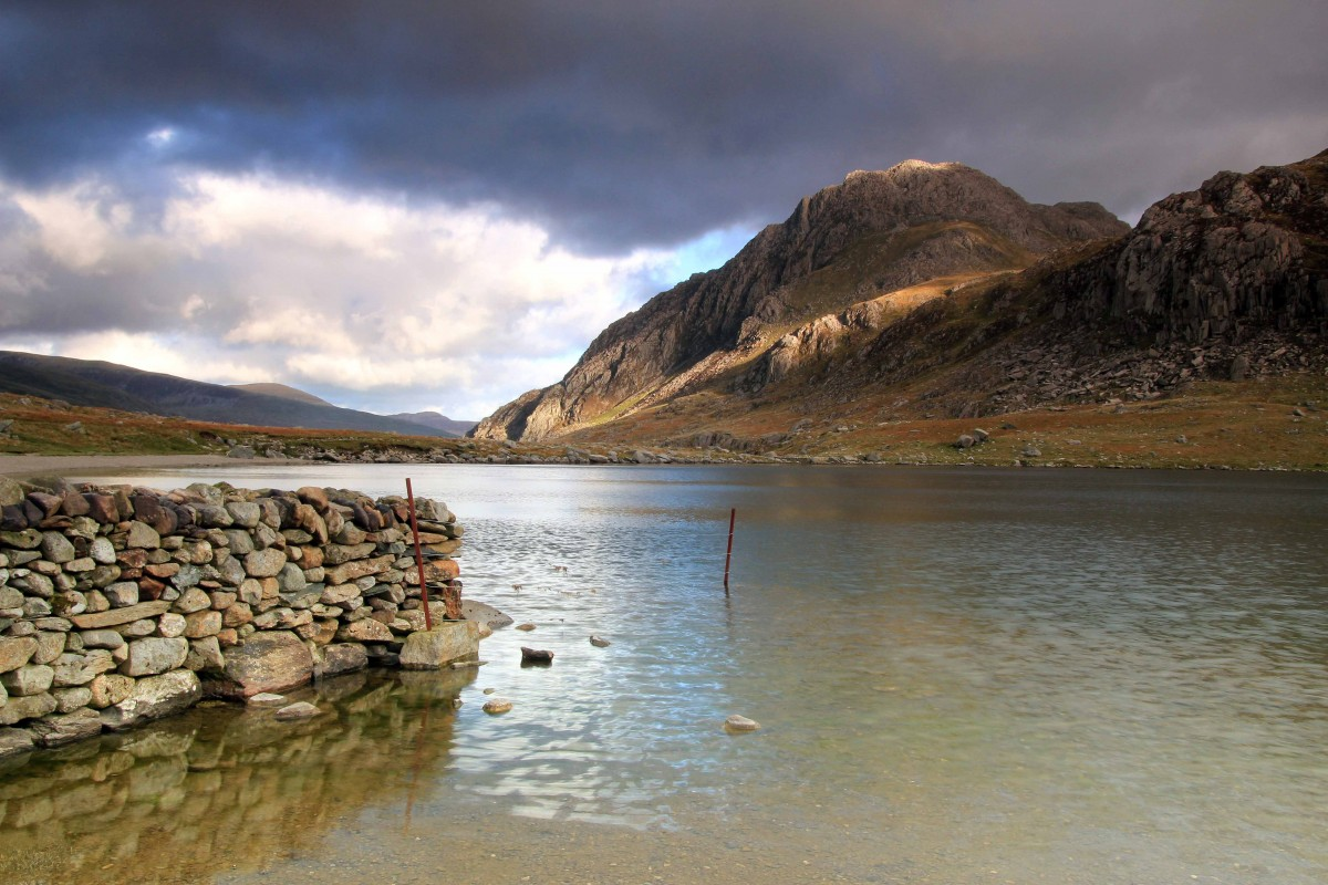 Sunlight catches the summit of Tryfan - Introduction to Mountain Photography - Develop My Mountain Photography